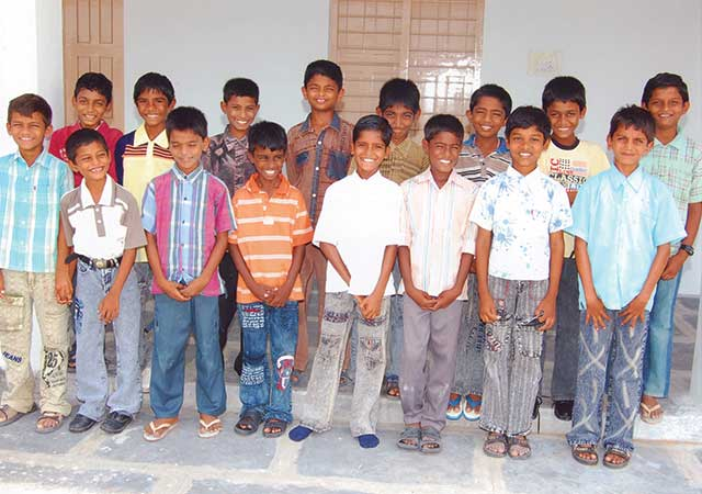 Kids dressed up inside the St Thomas Orphanage in India - by Abode for Children