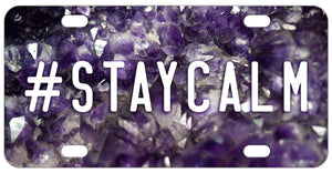 Cluster of Amethyst Crystals as the background of this custom license plate. We have hashtag stay calm for the sample but you can personalize with any text
