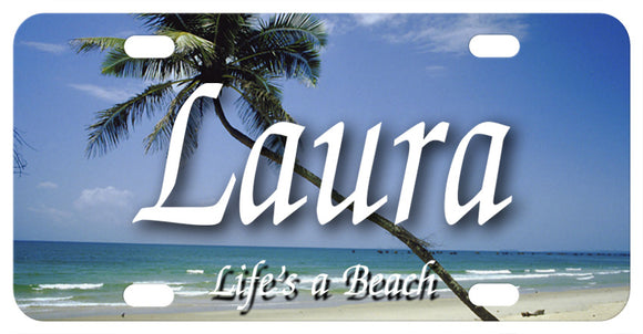 Beach with slanted palm tree going diagonally up the plate from right to left. Any name in the center. We've Added Life's A Beach to the bottom, but you can personalize with any custom text on bottom and top too