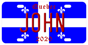 blue with white cross and 4 fleur de lis the qubec license plate can be personalized with any name in center