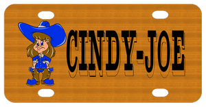 Cowgirl dressed in blue and brown on left with wood look background and name on right