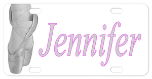 Greyscale depiction of ballet dancers feet in toe shoes on pointe, with any name personalized on a custom license plate for ballerinas.