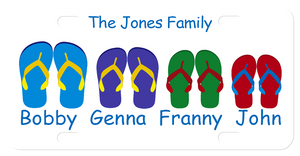Personalized on top with family name and individual names under pairs of flip flops in different colors and sizes. 4 pairs of flip flops shown.  The more pairs, the smaller they and the text will be