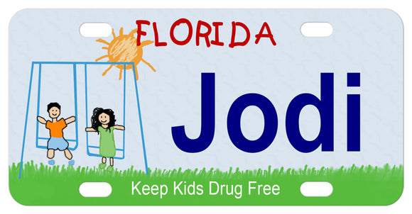 Florida license plate with kids on swing and sunshine