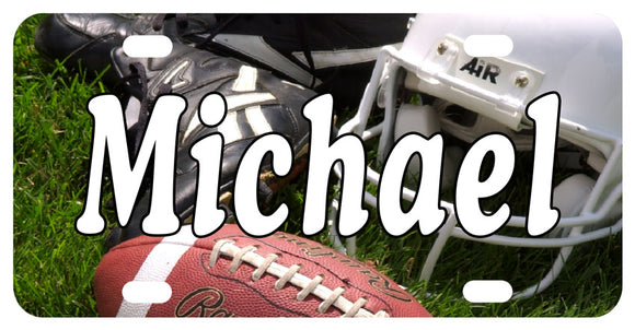 License Plate designed with Football, Helmet and Cleats on Grass and personalized with any name