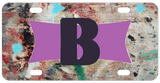 Grungy looking background with any name or initials on a purple ribbon frame personalized license plate