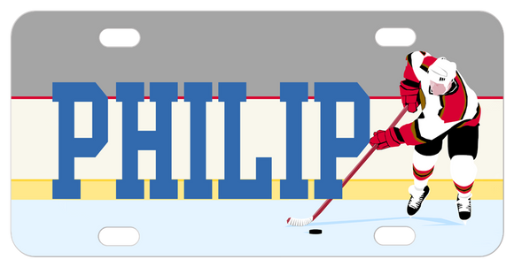 Hockey player pushing puck on ice to the right of any personalized name