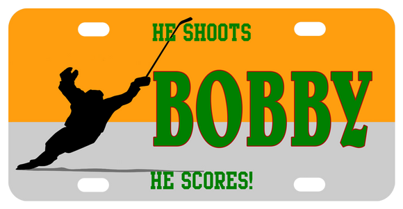 Hockey player skating with raised stick after shooting goal. personalized text on top, center, and bottom of license plate