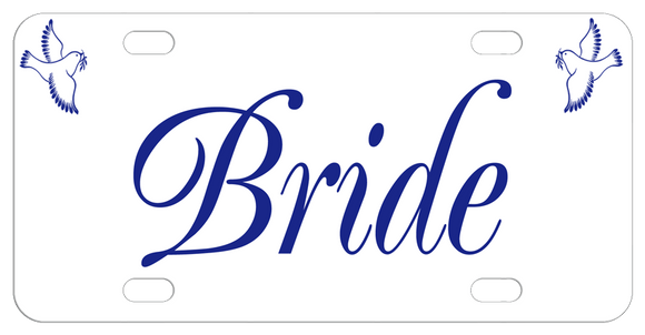 A dove in both top left and right corner with Bride in the center