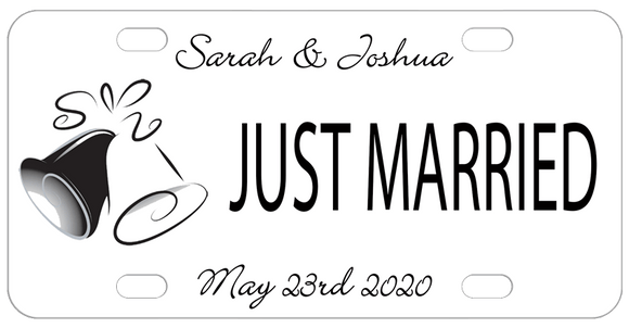 2 Wedding Bells 1 black 1 white on left with text on top, center and bottom. Plate is white with black text