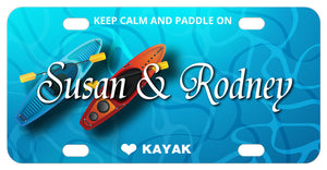 2 kayaks in water illustration on a custom license plate personalized with 2 names in the center and text on top and bottom