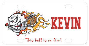 Personalized bike plate with lacrosse ball holding a LAX stick in it's mouth with trailing flames. Personalized with any name and custom text.