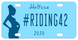 Blue Background with silhouette of a pregnant woman with a blue heart in her belly. Our sample reads #RIDING42 in the center with name on top and year on bottom. You can personalize with any text in all three areas