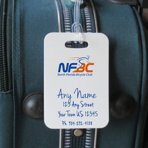 Luggage tag shown on luggage with logo and text for contact info