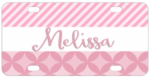 Pink Stripes on top and circled diamonds on bottom with white border in center with a name make this custom bike license plate so pretty in pink