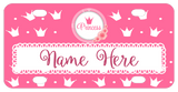 Pink Background with white crowns scattered on the plate Circle on top has a rose cluster on bottom and a pink crown and word princess. Your name is personalized in a white border towards the bottom of the plate