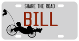 Recumbent Bike on bottom left of plain background license plate with your personalized text on top, center and bottom.