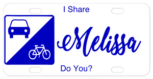 Sign on left with car and bike in triangle sections license plate design with your custom text to let everyone know you share the road