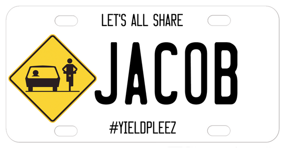 Diamond Yield Sign with Car and Cyclist sharing the road.
