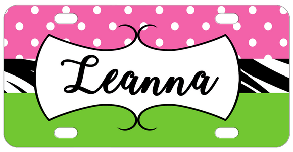 Personalized license plate with pink polka dots on top zebra band in the center and lime green bottom. Any name in a white frame in the center