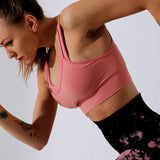 Pink shock-proof full coverage padded support moisture wicking breathable sports bra Keliana
