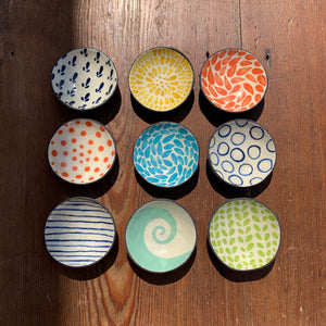 small hand decorated pinch pots