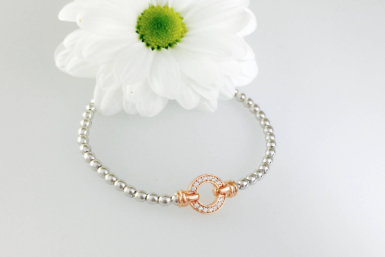 Exquisite Silver Designer Circle Bracelet.  Rose gold pave set circle.