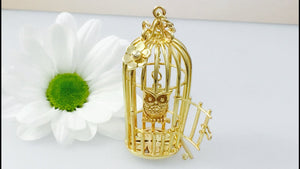 9ct Gold Birdcage necklace with owl statement piece.