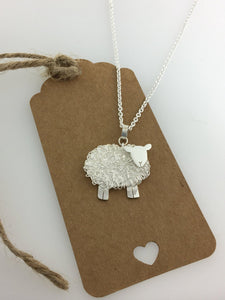 Handmade silver sheep necklace, individually crafted in Wales at Jeffs Jewellers.