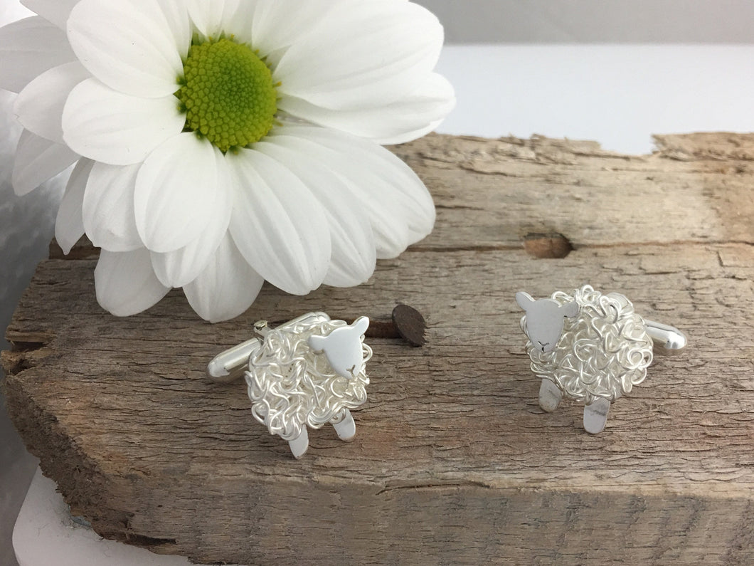 Handmade silver sheep cufflinks, individually crafted in Wales at Jeffs Jewellers.