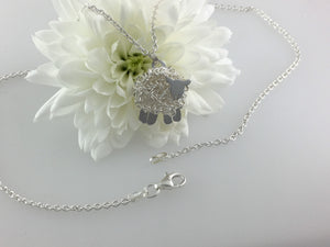Silver sheep necklace, individually hand crafted in Wales at Jeffs Jewellers.
