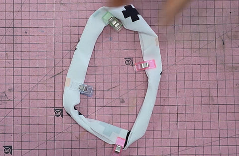 Quarter the neckband to sew it evenly on the t-shirt