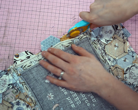 """trim the excess fabric away so that the seam allowance is 1/4"""""""
