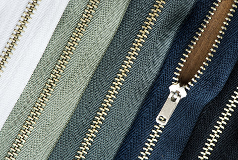 Assortment of metal zippers used for jeans making