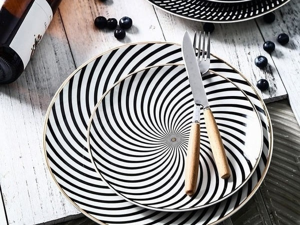 Fork and spoon on cosmos dinner plates