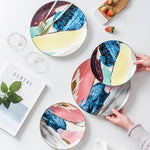 Load image into Gallery viewer, Four watercolor ceramic plates on a table