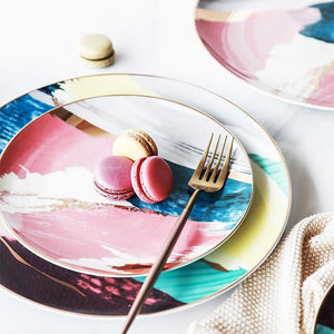 Two watercolor plates with macaroons