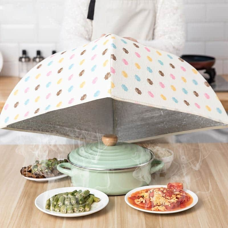 Vileep foldable food cover on a table with food