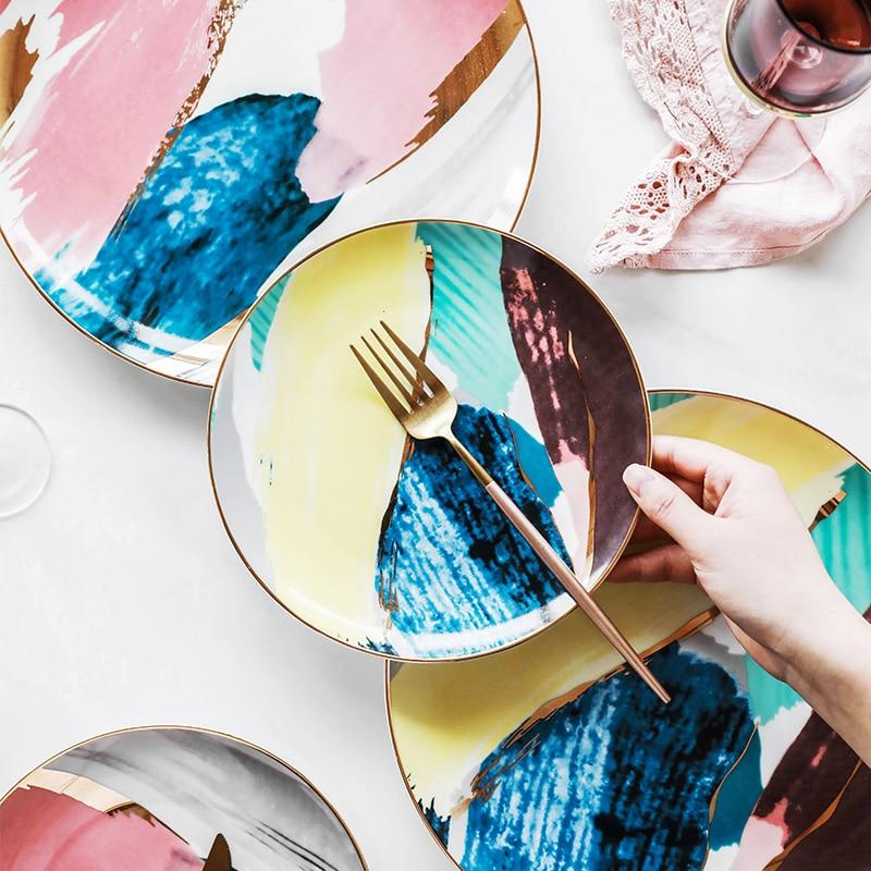 Watercolor ceramic dinner plates on a table