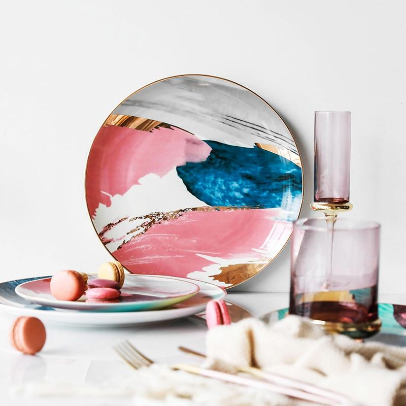 Watercolor pink plate on a table