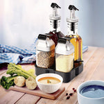 Load image into Gallery viewer, vileep oil and spice cruet set on a table