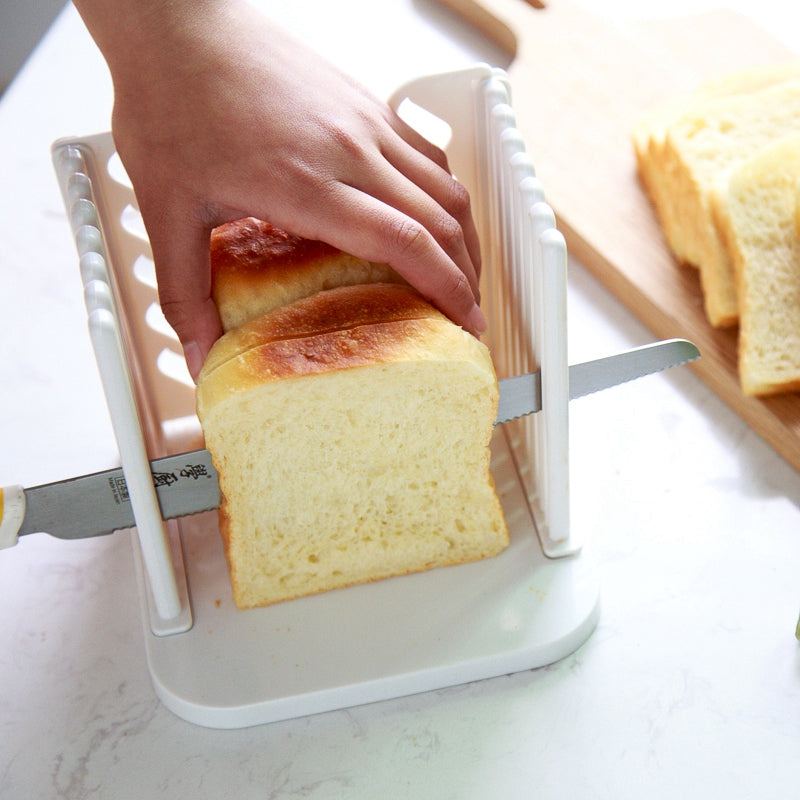 Slicing bread with a knife