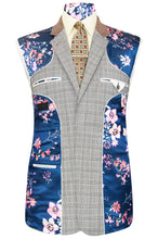 William Hunt Savile Row Grey three piece suit with barley overcheck featuring a blue base lining with pink floral bouquet highlights