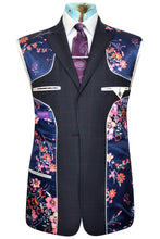 Navy three piece suit with magenta overcheck featuring a navy lining with vibrant pink bouquet highlights