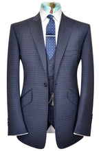 Blue three piece peak lapel check suit