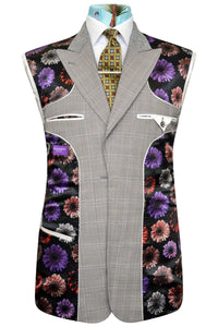 Orange over grey three piece windowpane check suit featuring a black base lining with multi-coloured floral pattern