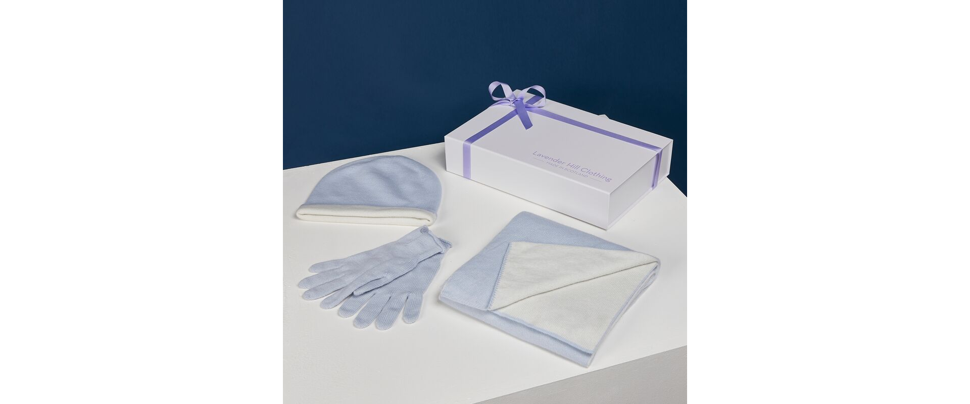 Blue cashmere gift set including cashmere hat, scarf, gloves and luxury gift box.