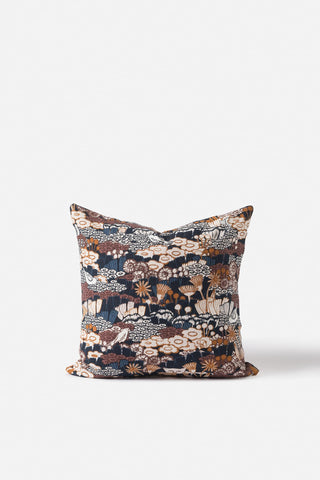 A patterned cushion by Citta in navy, brown and neutral tones.