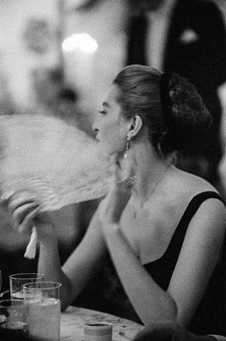 1957: French actress Capucine, (Germaine Lefebvre) (1933 - 1990) fanning herself at a New Years Eve party held at Romanoffs in Beverly Hills.