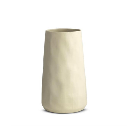 A hand cast tulip shaped ceramic vase in chalk white with natural dimpled finish.